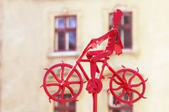 A man is riding a bicycle. Metal figure. Stock Image