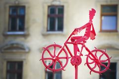 A man is riding a bicycle. Metal figure. Royalty Free Stock Images