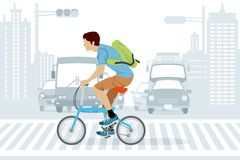 Man riding bicycle in Rush Hour Stock Image