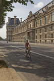 Man riding a bicycle on the street of Paris Royalty Free Stock Photo