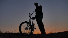 The man is riding a bicycle. Travel silhouette sunset sunrise sunlight traveler. Man is riding a bicycle. Travel silhouette sunset sunrise sunlight traveler royalty free stock photography