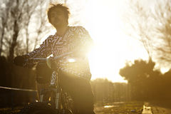 Man Riding Bicycle at Twilight Royalty Free Stock Photography