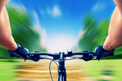 Man riding on a bicycle Stock Image