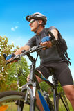 Man riding bike. Man on bike riding, natural background stock image