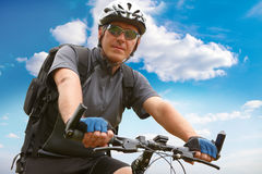 Man riding bike. Man on bike riding, natural background Royalty Free Stock Photos