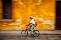 Man Riding a Bike with a blurry colorful background royalty free stock photos
