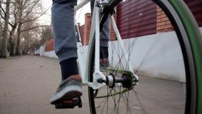 Man riding bike down the urban street, outdoor sport acivity, healthy lifestyle stock footage