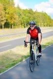 Man riding bike Stock Images