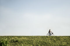 Man riding a bike Royalty Free Stock Photography
