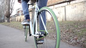 Man riding bike with green tyres slowly, healthy lifestyle, outdoor activity stock footage