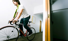 Man Riding a Bike in the Hall Stock Photography