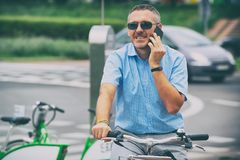 Man riding a city bicycle in formal style stock image