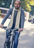 Man riding bike outdoors. Handsome young boy taking a tour bicycle and smiling - Vintage autumn look Royalty Free Stock Photo