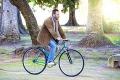 Man riding in bike Stock Image