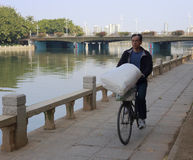 Man riding bike with quilts. Amoy city,china Stock Photo