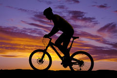 Man riding a bike in the sunset Royalty Free Stock Photography