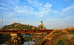 Man riding bike at Vietnamese countryside Royalty Free Stock Images
