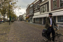 Man riding a bike in Vlaardingen in the Netherlands Stock Images