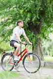 Man riding a bike Stock Photos