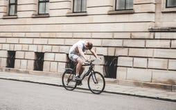 Man Riding Black Mountain Bike on Pathway during Daytime Stock Photo