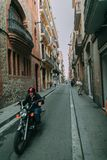 Man Riding Black Standard Motorcycle Royalty Free Stock Photography