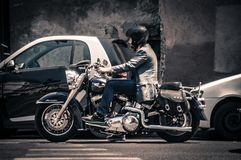 Man Riding a Black Touring Motorcycle Royalty Free Stock Images