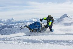 Man Riding Blue Snow Ski Scooter Royalty Free Stock Photo