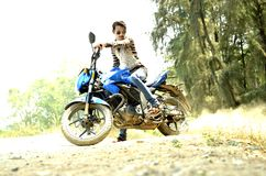 Man Riding Blue Sports Bike Stock Photography