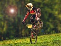 Man riding bmx bike performing a trick Stock Image