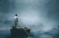 A man riding boat in fog. Early morning , boating on the lake in a huge fog Royalty Free Stock Photos