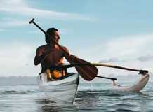 Man Riding on Boat Holding Brown Paddle royalty free stock images