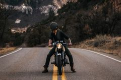 Man Riding Boxer Motorcycle on Road Stock Photo