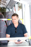 Man riding a bus Stock Photo