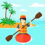 Man riding in canoe. Royalty Free Stock Photography
