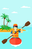 Man riding in canoe. Stock Photos