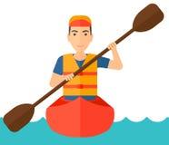 Man riding in canoe Stock Photo
