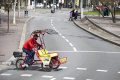 Man riding chariot bike crossing the street. Barcelona, Spain. Stock Image