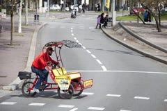 Man riding chariot bike crossing the street. Barcelona, Spain. Stock Image