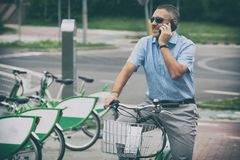 Man riding a city bicycle in formal style Royalty Free Stock Image