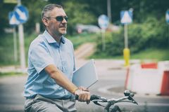 Man riding a city bicycle in formal style Royalty Free Stock Images