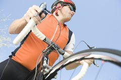 Man Riding Cycle Against Blue Sky Royalty Free Stock Image
