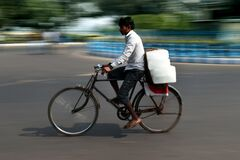 A man is riding a cycle in kolkata at Dharmatala.
