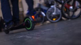Man riding electric kick scooter, ecological transport, two-wheel revolution. Stock footage stock footage
