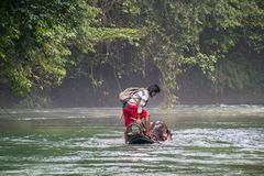Man Riding Elephant in River. Elephant Drowning in River. Tangka. A Man Riding an Elephant in River. Elephant Drowning in River. Located in Tangkahan, Indonesia Royalty Free Stock Image