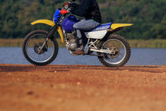 Man riding enduro motorcycle on dirt field Royalty Free Stock Images