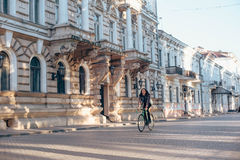 Man riding fixed-gear bicycle Stock Photography