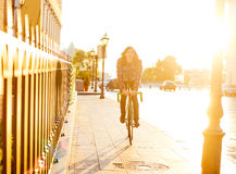 Man riding fixed-gear bicycle Stock Photo