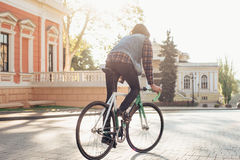 Man riding fixed-gear bicycle Royalty Free Stock Image