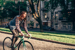 Man riding fixed-gear bicycle Stock Image
