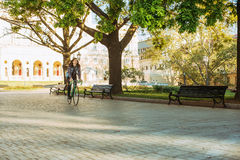 Man riding fixed-gear bicycle Stock Images